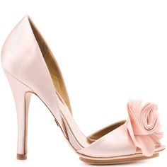 Slip these elegant party heels from luxe fancy shoe designer Badgley Mischka onto your feet and dance the night away. Randall is a sandal in pink satin featuring a covered 4 1/2 inch stiletto heel and a small 1/2 inch recessed platform. A soft pink fabric flower-like detail at the vamp swishes and sways with your every move, a flowing look sure to perfect your occasion dress.