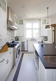 My kitchen could pull this off--white cabinets, black counters and hex tiles.