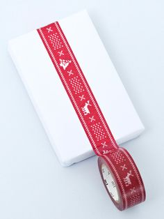 """Red Christmas """"knit"""" tape."""