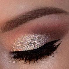 Really cute eye idea. Sparkly eye shadow with eyeliner, mascara and kind of a caramel to a dark brown eye shadow with a little white on the brow line.