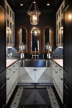 Chic butler's pantry - black walls, white cabinets, lots of bling.