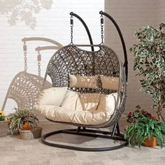 The Brampton is the perfect addition to any outdoor living space. The Brampton double Cocoon hanging chair comes with an espresso brown rattan design, completed with beige Cushions. This swing is supported by a strong and durable aluminum chain and b Egg Swing Chair, Hanging Swing Chair, Swinging Chair, Swing Chairs, Garden Swing Chair, Hanging Beds, Hanging Chairs, Swing Seat, Hanging Rope