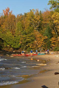Sea kayakers coming ashore to camp at Mosquito Beach, Pictured Rocks National Lakeshore, Upper Peninsula, Michigan (2007)