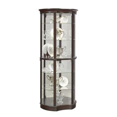 Featuring a unique curved shape and a luxurious, dark brown finish, this Concave Front Door Entry Curio Cabinet itself itself will become an art piece in your home. The glass shelves and mirror back b