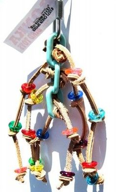 1571 Chain spyder, a wonderful array of tied leather knots decorated with colorful plastic ring discs woven through a solid plastic link chain.
