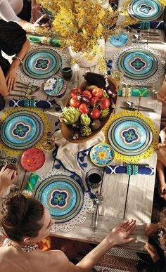 Mix of colors, patterns, style, and personality come together to make one Beautiful Table!
