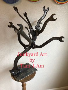 """Junkyard Art by Tam-I-Am. Repurposed wrenches are welded together to make this """"Mechanic's Shade Tree."""" Scrap metal art."""