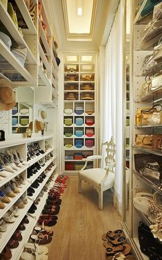 Must have this accessories closet.  Ladies and Gentlemen, this is how you maximize your useage of a narrow walk-in closet! Floor to ceiling shelving. Love the bedroom chair angled in the doorway, to make sitting and putting on shoes easier by making the choices within reach. And of course, I organize 99% of my closet by color, so I heart this.