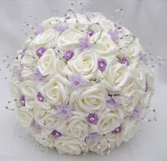 Beautiful Posy in Ivory Lilac Silver Posy Measures approx 9inchs in diameter This beautiful new posy has been created using an array of delicate