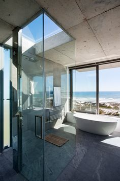CONCRETE AND GLASS. BIT COLD AS IS, NEEDS ORNATE DETAILS TO SOFTEN. Pearl Bay Residence by Gavin Maddock Design Studio