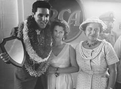 Elvis posing with fans at the USS Arizona Memorial press conference, March 25, 1961.