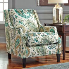 Pops of paisley and cool, on-trend hues lend Lochian's Living Room Collection by BenchCraft traditional lines an updated look. Polyester chenille upholstery over sturdy frames. Exposed feet with faux wood finish.