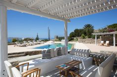 Mykonos pool villa with stunning sea views. Elegant holiday home with BBQ and shadded outdoors dining and seating areas. A celebration of life. Outdoor Furniture Sets, Outdoor Decor, Mykonos, Greece, Pergola, Bbq, Villa, Outdoor Structures, Artist