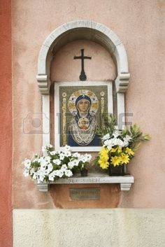 Madonna and Child mosaic at outdoor shrine in Italy.