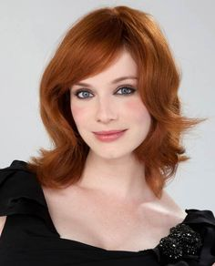 Christina Hendricks with side swept bangs and soft layers. Maybe not the most up to date look for some, but I still dig this look.