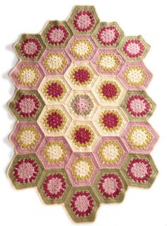 Floral Hexagon Afghan - skill level intermediate. This colorful hexagon afghan is made in pieces and then crocheted together, making it a great travel project, via Lion Brand Yarns pattern