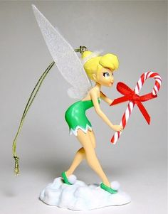"""Looks like Tinker Bell is already storing away candy canes for Christmas! TINKER BELL WITH CANDY CANE ORNAMENT (from Walt Disney's """"Peter Pan"""")"""