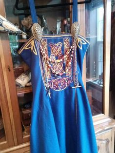 Hand embroidered. Chain stitch. Viking overdress. Love the embroidery design in the corners at the top