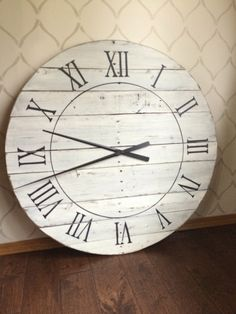 This FULLY FUNCTIONING CLOCK adds so much character as a BOLD statement piece for your home! Handcut from solid reclaimed wood sanded down & painted to perfection in a beautiful antique white paint & medium distressed down to a dark walnut undertone. Roman numerals are painted on in black paint as well as an inner circle. Available as numerals instead of RNs in drop down menu. Clock is top coated with a polyurethane for protection. A high torque clock mechanism and long black hands are…