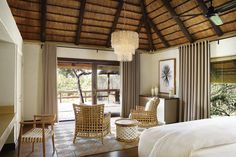 Founders Camp has a 'Bushveld Bohemia' style in which nature-based colours are accentuated by wallpaper and handmade cushions for a contemporary safari feel. This camp uses recycled elements of nature in their most natural and raw form. Bamboo House Bali, African Interior Design, African Design, Thatched House, Best Interior, Modern Interior, Lodges, My Dream Home, Game Reserve