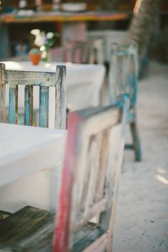 weathered beach chairs used for cocktail hour |  Photography by emilylblake.com |  Event Planning by destinationweddingstulum.com |   Read more - http://www.stylemepretty.com/2013/07/01/tulum-wedding-from-emily-blake-photography/