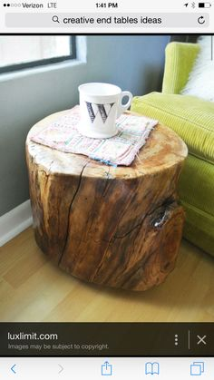 Just an old piece of firewood paint it / polyurethane it and you have a neat end table . If you want you could even drill holes in bottom and add wheels for easy moving.