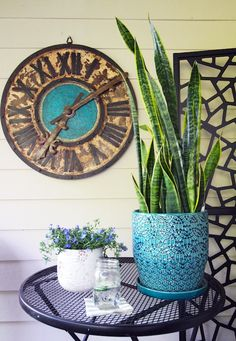 We love the color coordination-- blues, browns and green-- on this patio. The snake plant is low-maintenance, too! See how Erika Ward of BluLabel Bungalow brightened up her patio with container gardening... on The Home Depot Blog. || @mrserikaward
