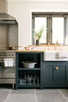Farmhouse sink and dark gray cabinets