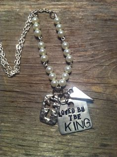 Loved by the KING.  Hand stamped jewelry found on FB: Leave it at the Cross 3:16