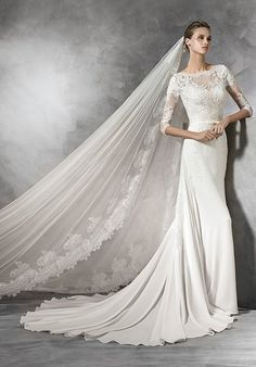 Mermaid styled wedding dress with bateau neckline and lace bodice I Style: TANE I by PRONOVIAS I http://knot.ly/6494BL5ae