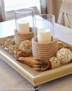 What a pretty tray with found objects and some scrap rope to dress those vases...it's a little beach on a tray!