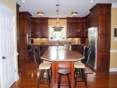 Large kitchen open to breakfast room and access to dining room.  NDG 668 - Willow Lane