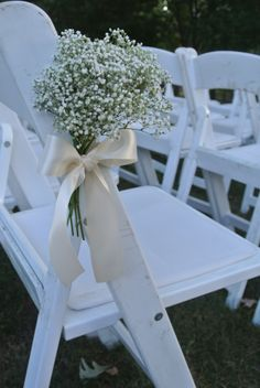 Babies Breath with a bow on chairs for outdoor ceremony.  (I made these)