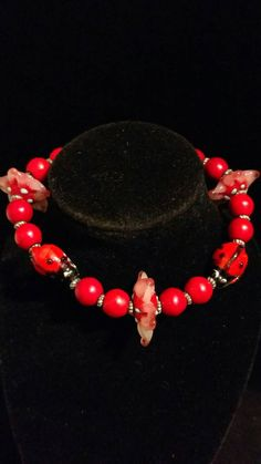 Check out this item in my Etsy shop https://www.etsy.com/listing/400281481/ladybugs-lampwork-bracelet-size-8