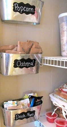 Use small tubs on the narrow wall on the inside of the pantry to hold packets/mixes
