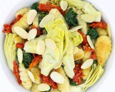 Ricotta Gnocchi - Pan seared potato & ricotta gnocchi, almonds, sun-dried tomatoes, artichoke hearts, spinach, sage brown butter