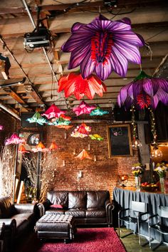 The ceiling of Mark Winkel's apartment sprouts foam flowers as big as a man's torso, several trapeze swings and a half-dozen chandeliers and pendant lights entwined with 1,000 roses. Foam flowers by Gregory Skolozdra.