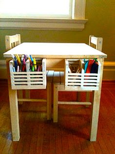 Art table with Ikea utensil holders as supply boxes