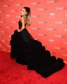 Ariana Grande makes a statement with a dramatic train at the TIME 100 Gala. See all the best celebrity red carpet fashion looks from the night here: