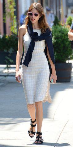 Alexa Chung Makes Preppy Dressing: Cutler & Gross sunglasses Isabel Marant sweater Reformation dress Dior earring.   Gucci sandals