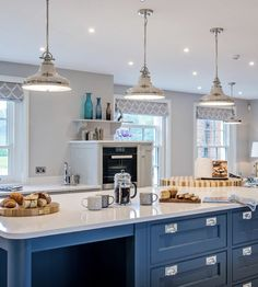 A pop of blue adds charm and style against a neutral backdrop, making the island the central focus point in this elegant shaker style kitchen Shaker Style Kitchens, Kitchen Designs, Entertainment Center, Bold Colors, Backdrops, Neutral, Entertaining, Island, Pop