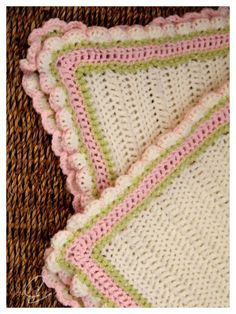 Pretty pink, green, and white blanket