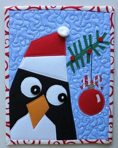 a penguin holiday mug rug