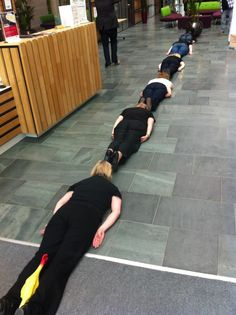 The Green Umbrella Team (and chicken Dave), doing a very long plank at the icon centre. lol