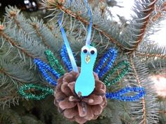 Pine Cone Peacock Ornament - The Kid's Fun Review || 10 Homemade Christmas Ornaments for Kids: Inspired by Nature!