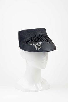 A unique and stylish army style cap with laser-cut leather brim by Studio Aniss