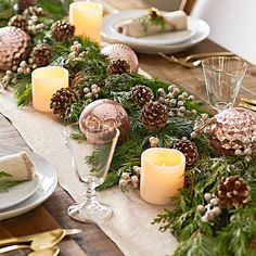 Use garland in unexpected ways, such as winding it along a tabletop as a centerpiece. Make sure to place a runner underneath to ground the decor and keep scratches off the table. Then get creative with ornaments – Christmas balls, berries and pinecones – and inset gleaming votives to give the arrangement a little lighting.