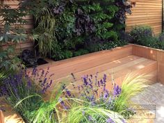 See pictures and details of how Garden Club London transformed a stark, paved area, into a beautiful garden fitting of the Victorian property.
