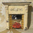 This is an adorable little cast metal doll's house fireplace - perfect for English houses circa late 1800's - early 1900's. It is painted,