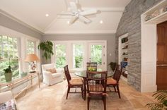 Cute clashing of dining room and sun room:)!